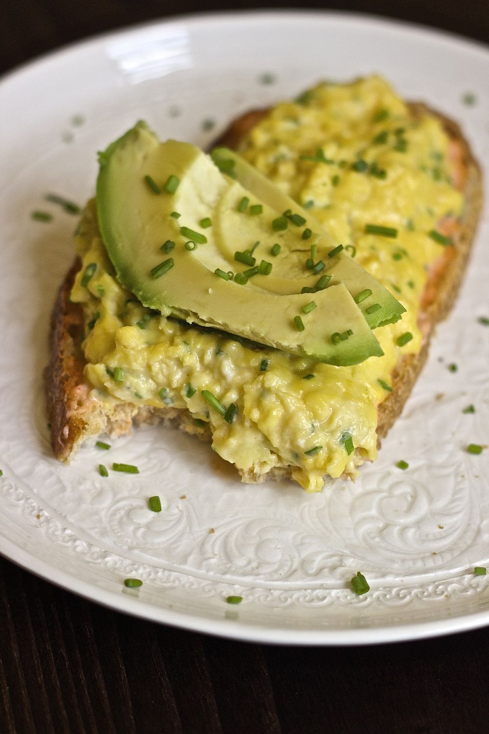 Creamiest Scrambled Egg Tartine with Sriracha Aioli, Goat Cheese, & Avocado | Kneading Home
