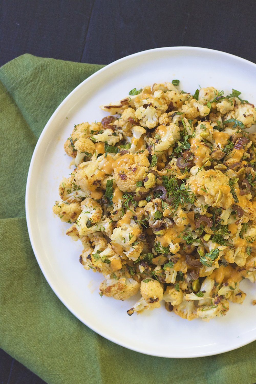 Moroccan Roasted Cauliflower with Tahini Dressing, Pistachios & Dates | Kneading Home