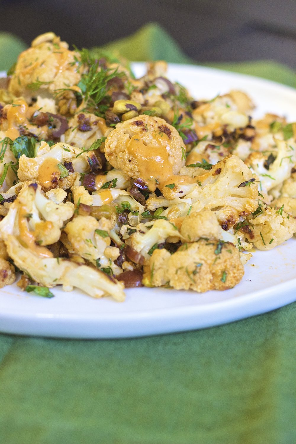 Moroccan Roasted Cauliflower with Tahini, Pistachios, and Dates | Kneading Home