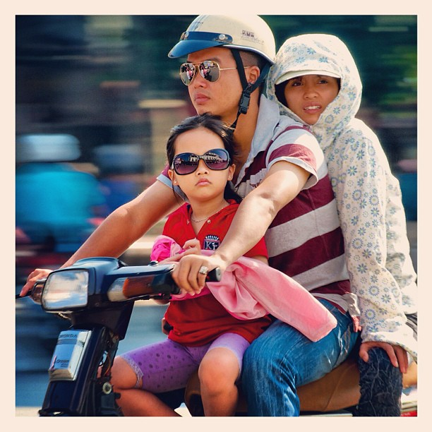 Three on a bike. #hanoi #vietnam #moped #photo #photography #travel #asia  www.soperimages.com