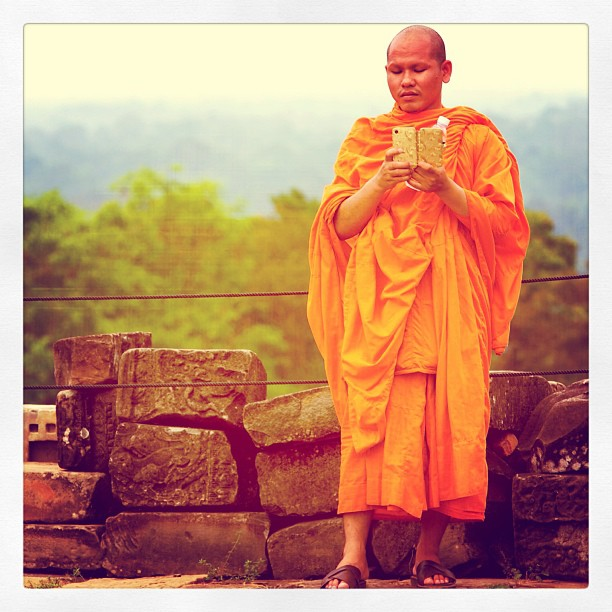 #monk on #iphone, #Angkor Temples, Siem Reap, #Cambodia.  www.soperimages.com