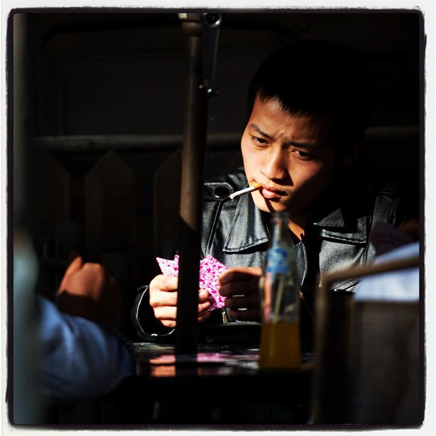 Card players, 798 Art District, Beijing. #cards #cigarette #smoking #games #beijing #china www.soperimages.com