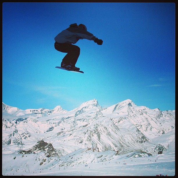 Griff jumps over the Alps. www.soperimages.com #snow #alps #ski #skiing #snowboard #snowboarding #sport #mountains