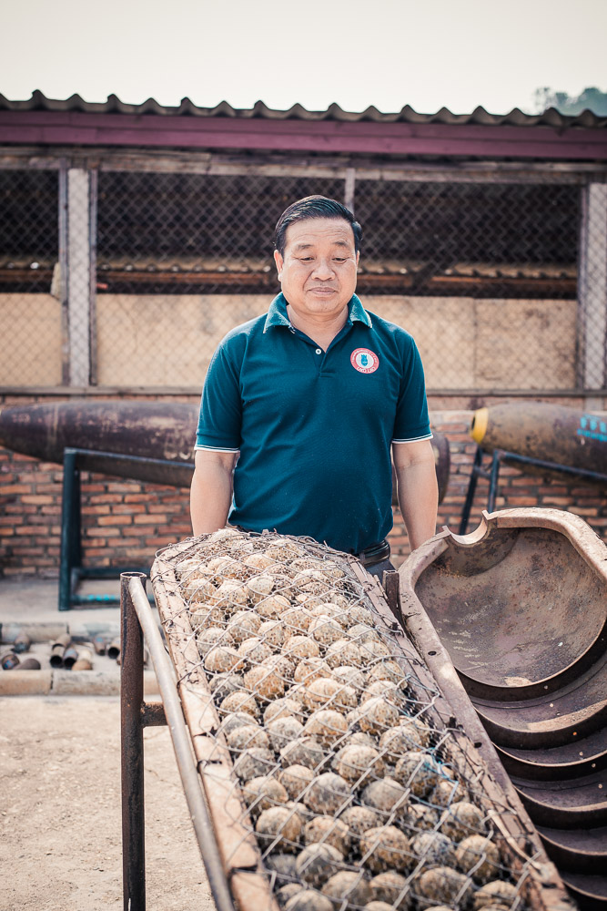UXO Laos Provincial Coordinator Kingphet Phimmavong and a shell packed with 'bombies'. Of the 260m 'bombies that rained down, 80m failed to explode, leaving a deadly legacy.