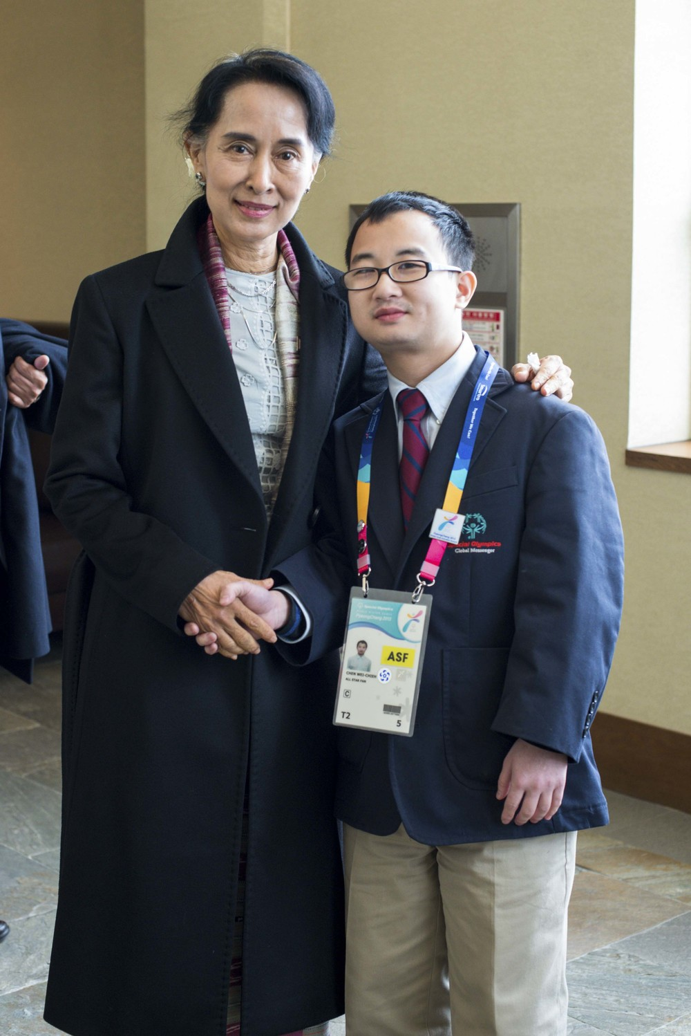 Aung San Suu Kyi meets a participant at The Special Olympics Winter Games, Korea, February 2013