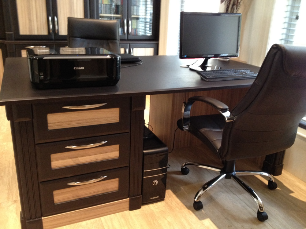 Unique dark walnut home office with Cocobola drawer fronts