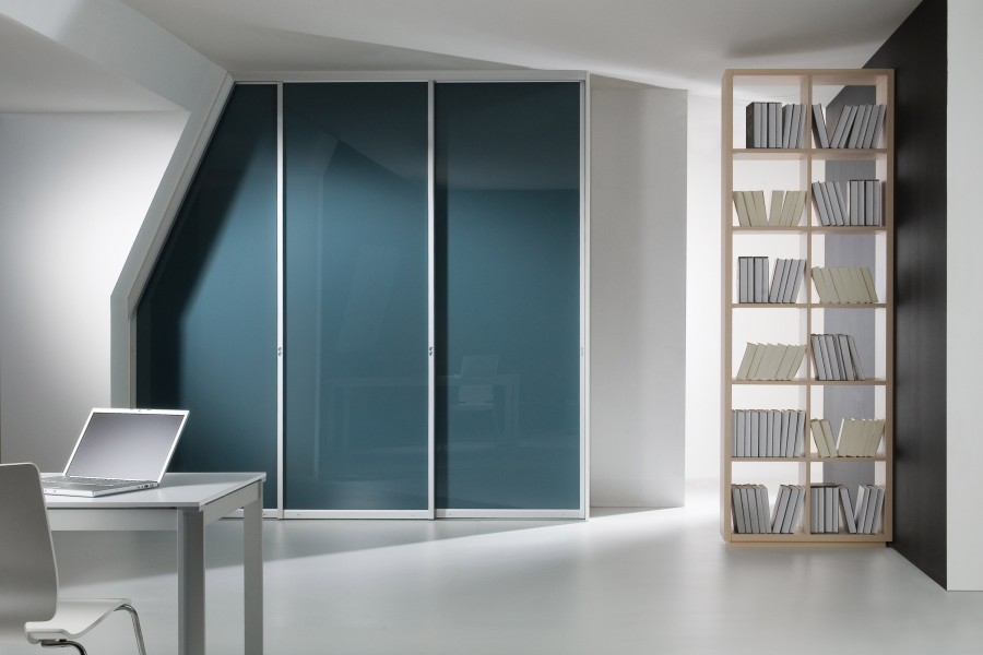 Sliding door wardrobes into an angled ceiling