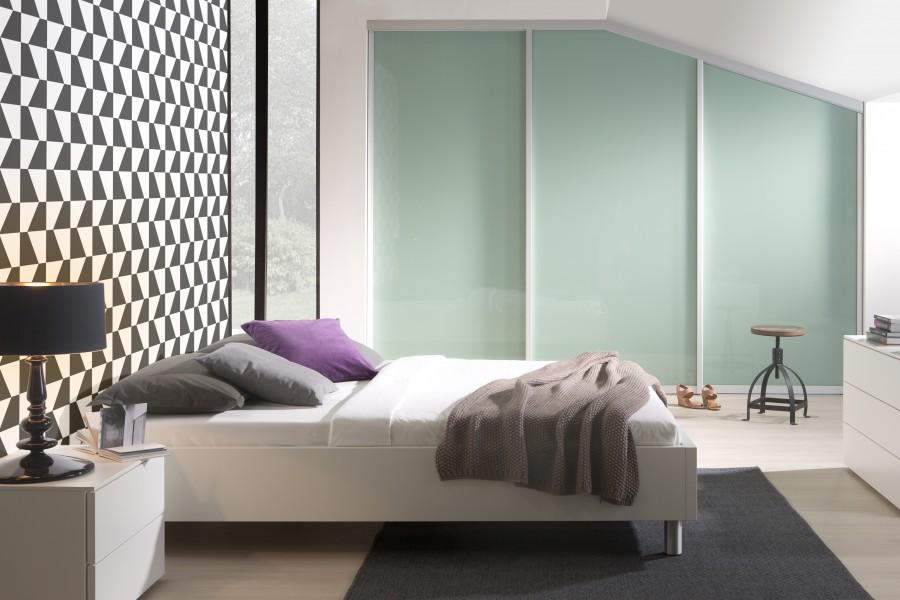 Custom bedroom angled wardrobes in mint green