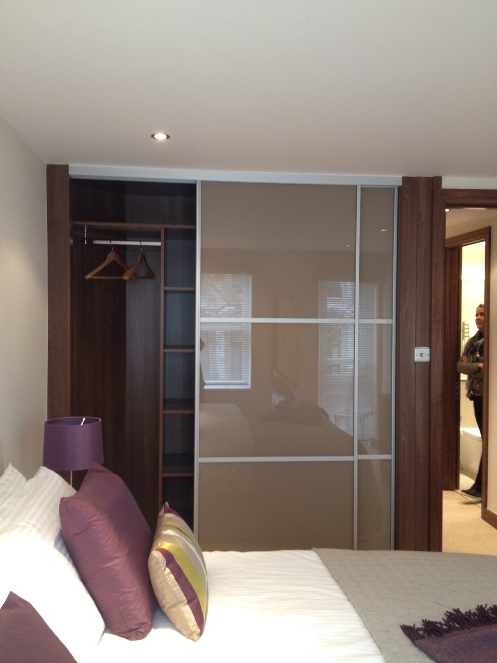 London - a sliding wardrobe for a commercial client. Additional framing to cover an unsightly wall and boxing inside to cover service facilities.