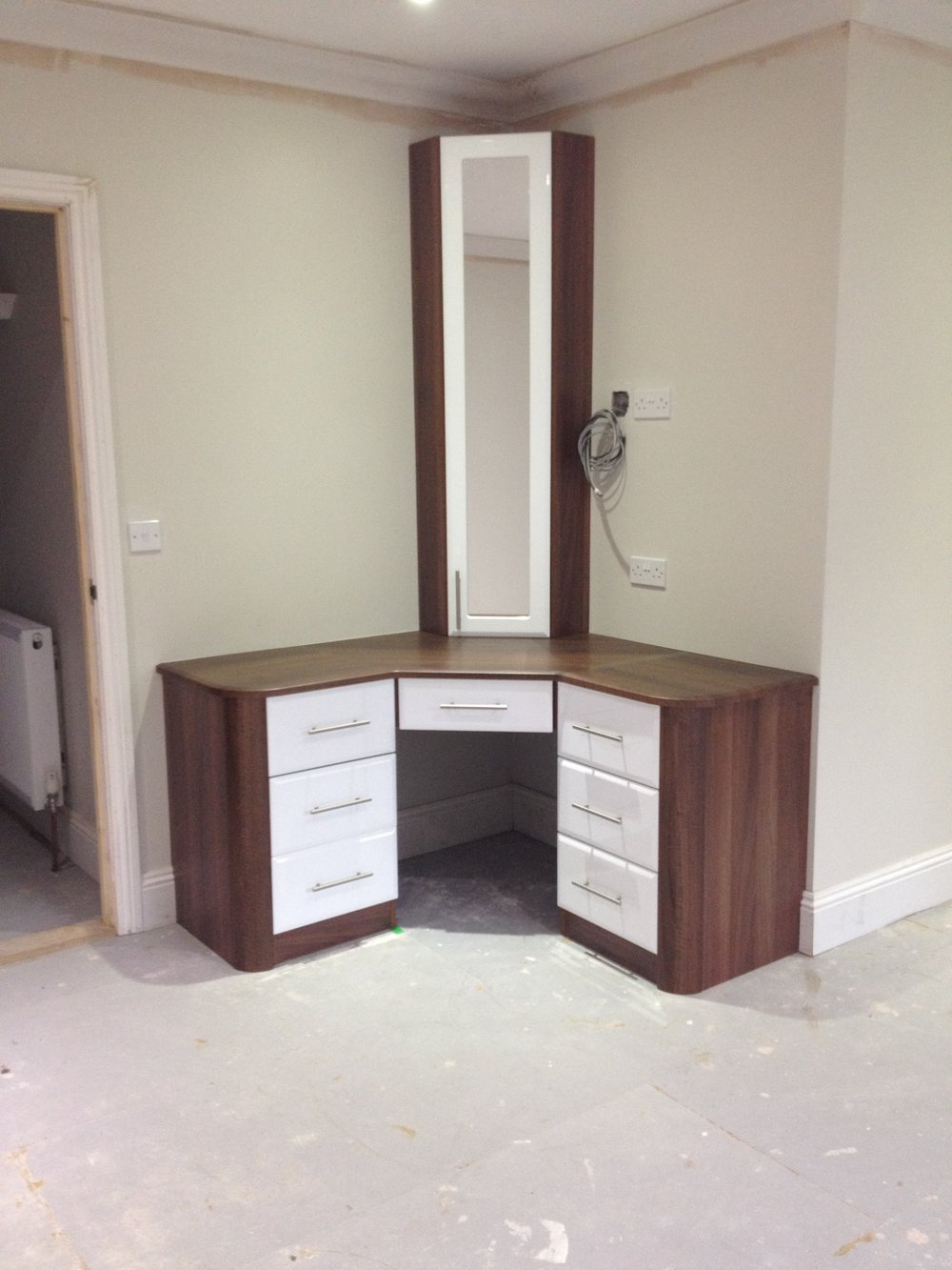 Warsash - A teen's dressing table and homework space in a very tight corner. Note the rounded end panels and corner mirrored cupboard.