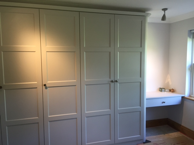 Locks Heath - painted look wardrobes in a soft matt grey. This is a much more practical finish which will look good without maintenance for years. The client here showed us magazine photo which we replicated for her.