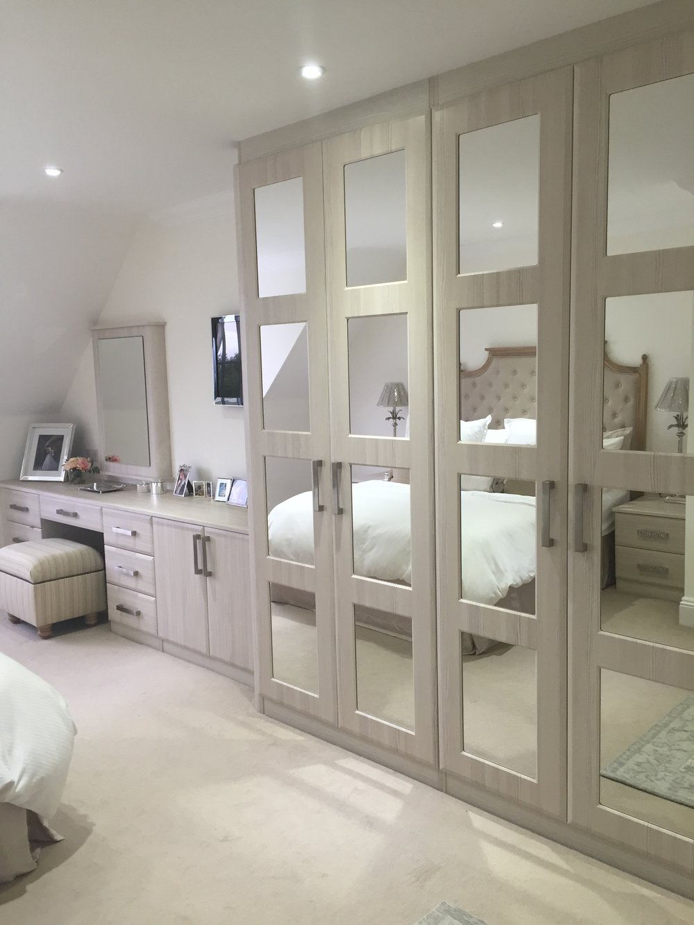 Titchfield - this lovely client wanted a shabby chic style room that was restful and calm, but also had loads of storage for her and her husband. This 'White Avola' colour fitted the bill beautifully and the mirrors brighten and reflect.