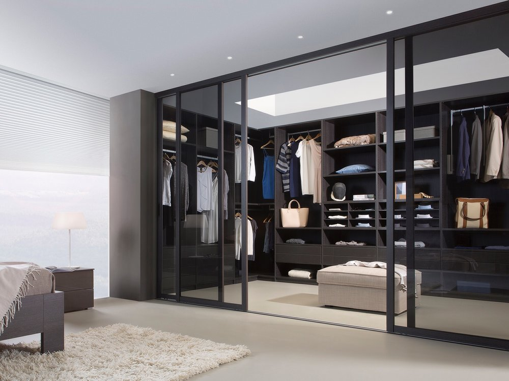 Noteborn Vice Versa 55 as a walk in closet in Cortina Grey shown with bronze clear toughened glass. Use as a wardrobe with mirror or lacquer glass colours.