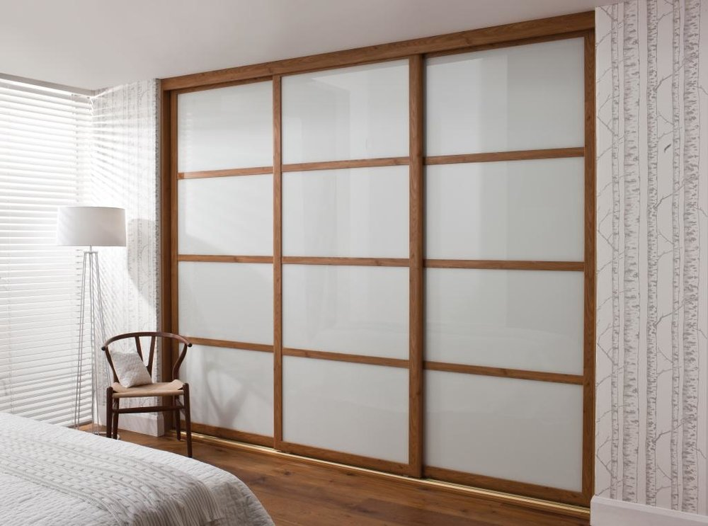 Pippy Oak Rio Sliding wardrobe with Pure White lacquer glass, exclusive to Deane This wardrobe around £3500 installed, or £2557 in plain mirror option.