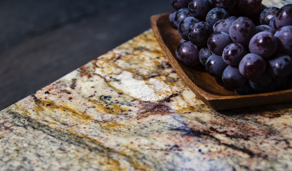 granite countertop with fruit on it