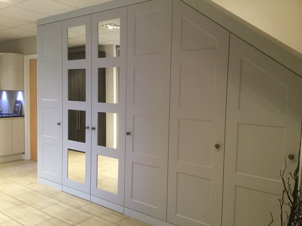 Dove Grey wardrobes with concealed study area and sloping doors