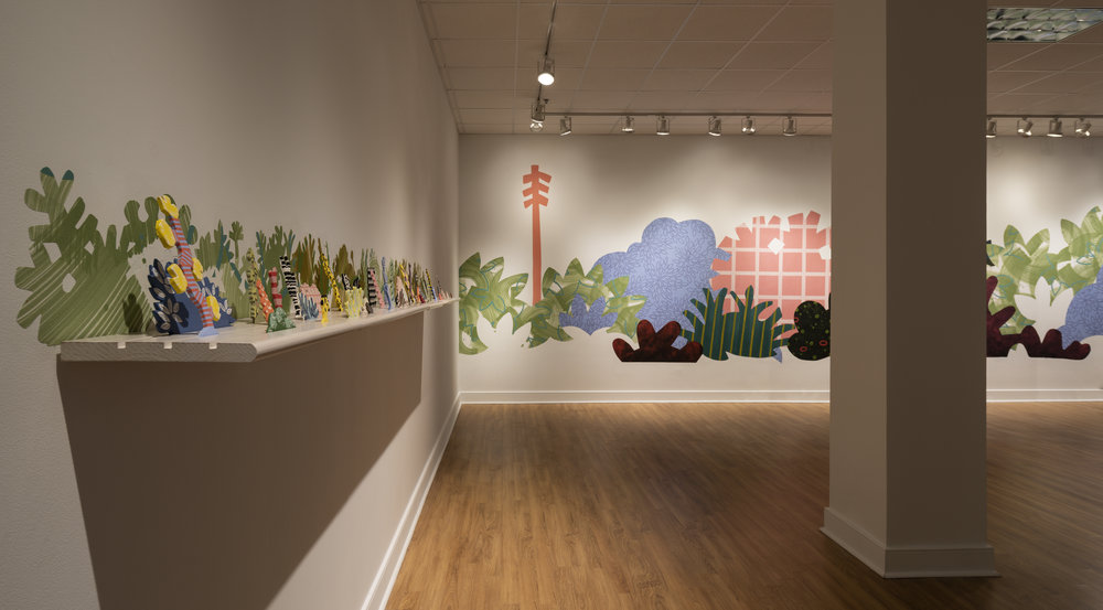 From right to left:     Piecemeal Promenade   (2019) 48ft x 11ft; latex on muslin cut-outs, adhered to wall;     Horizon Allsorts  , (2018) 12ft x 1ft; (6) floating wood shelves, painted muslin, ceramic, underglaze and glaze