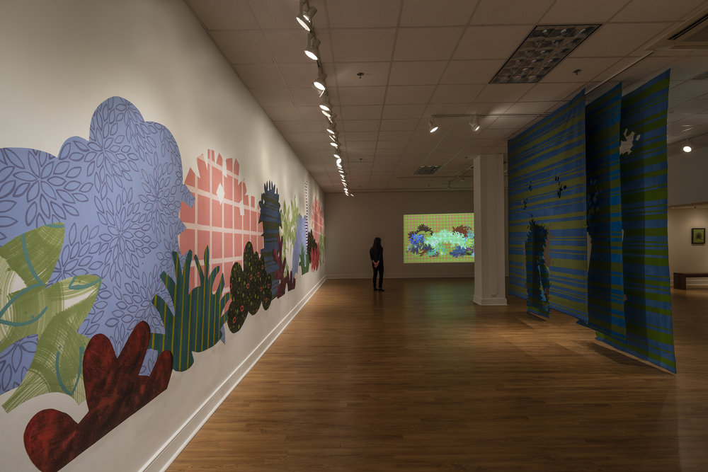 Works from right to left:     Proscenium Hedgerow   (2018) 11ft x 10ft x 2ft; series of three latex on cut muslin panels    Blinky Bricolage   (2019) 3 minute animation on loop, projection; collaboration with Kyle Statham     Piecemeal Promenade   (2019) 48ft x 11ft; latex on muslin cut-outs, adhered to wall;