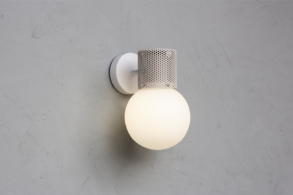 Perf wall sconce in off white - on