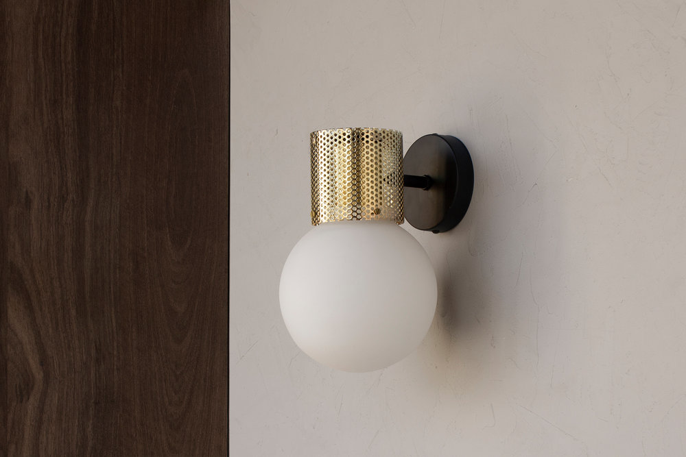 Perf wall sconce in brass