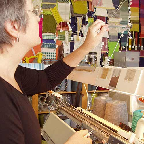 Susan Holton designs and creates her beautiful knitwear using a domestic knitting machine