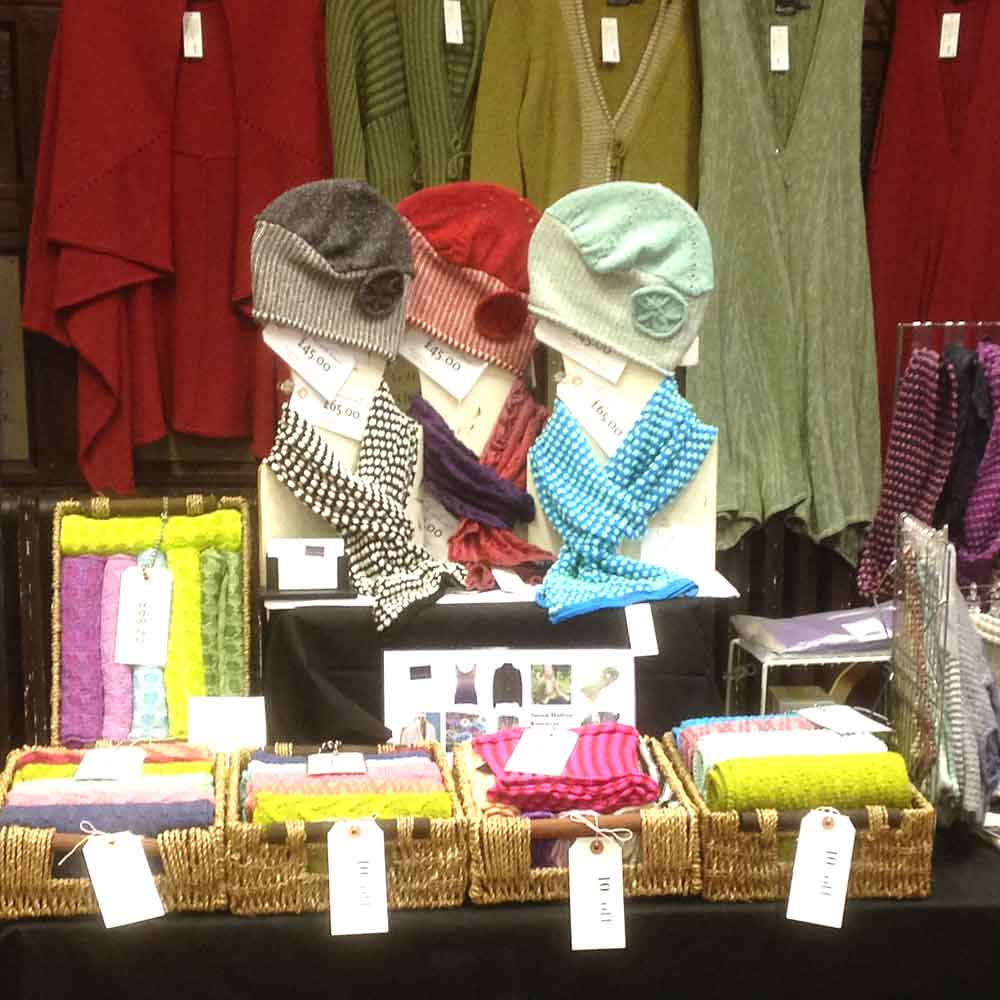 A close up of Susan Holton Knitwear's stand at 'Real Craft' at Charterhouse School