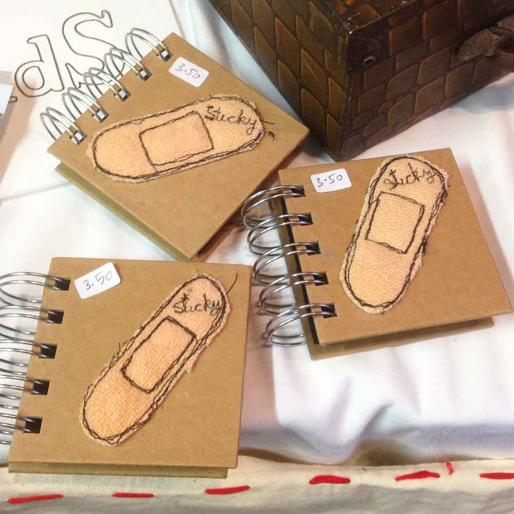 Machine stitched notebooks from Thimble and Thrift at 'Real Craft' at Charterhouse School