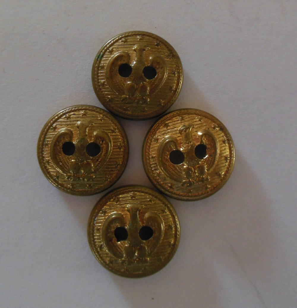 I haven't found anything on these two hole buttons to properly identify them.  They kind of look like the Navy Buttons but are not clutching an anchor.  I will let you know by editing the blog when I find out more about them.