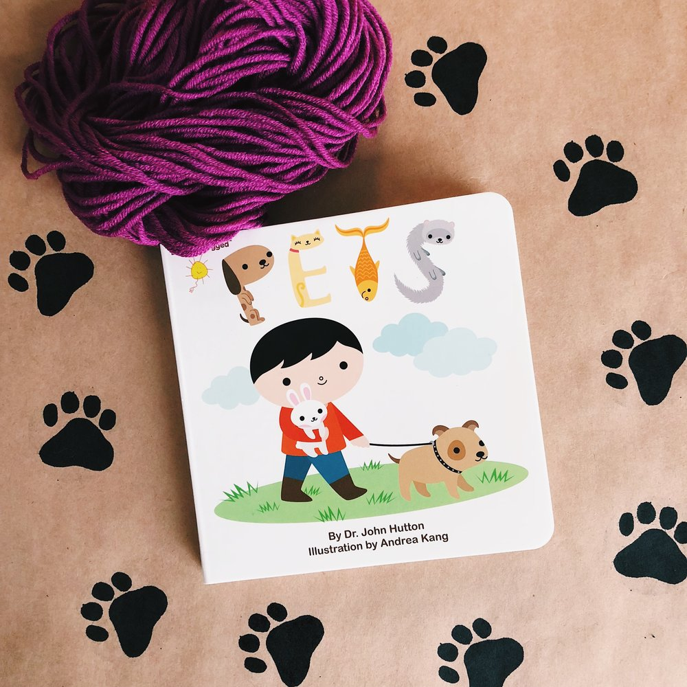 """""""Touch pets, feel pets; The best are real pets."""" -   Pets ,  written by Dr. John Hutton and illustrated by Andrea Kang"""