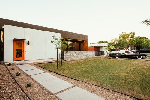 The house only has windows facing north and south, to control the heat gain and uses large opening to keep the house cool in the hot summer while allowing daylight in to heat the concrete slab floor in the winter to avoid using heating. Source