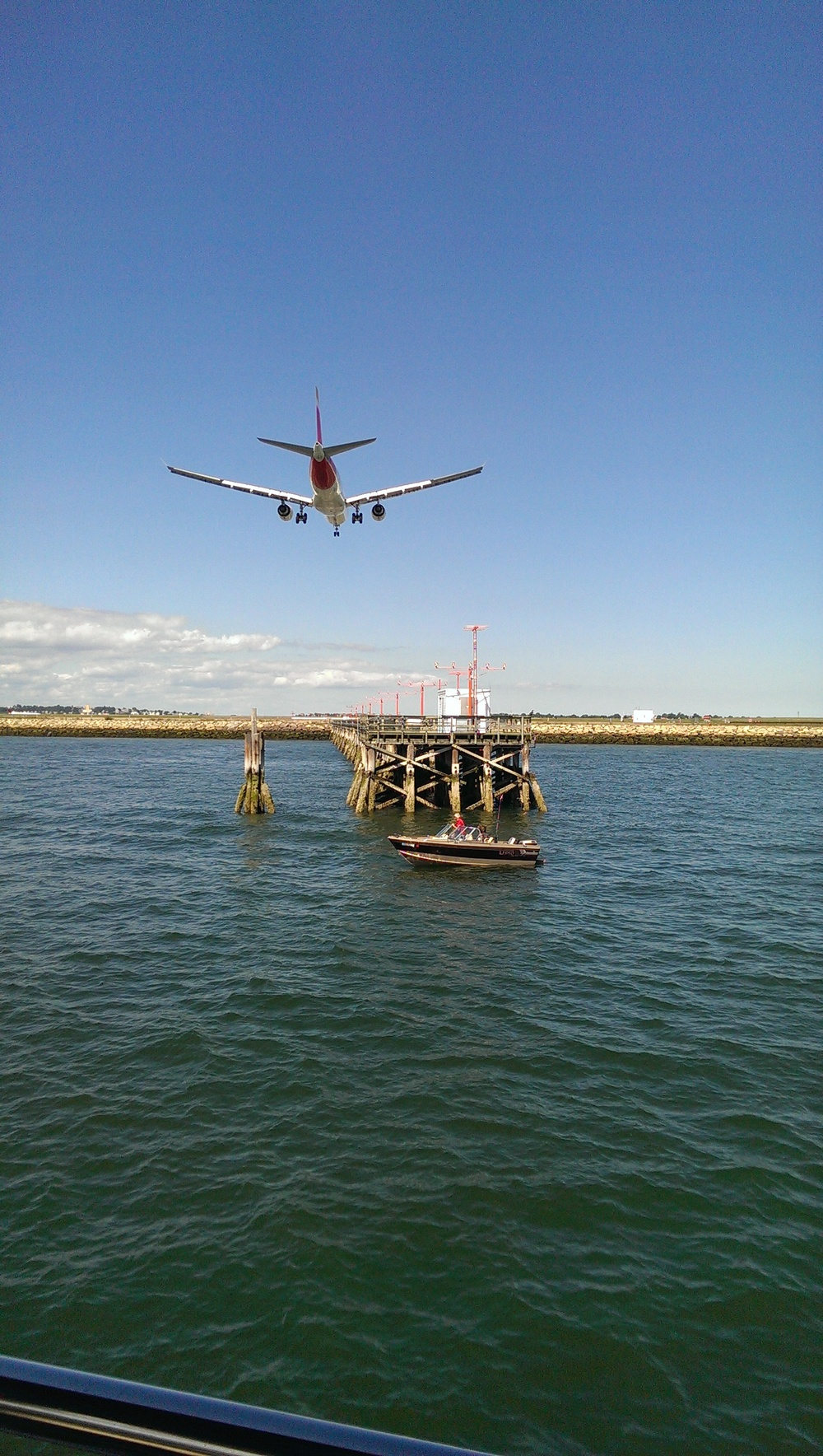 Commercial jets fly over our boat on its way to landing at Logan Airport.