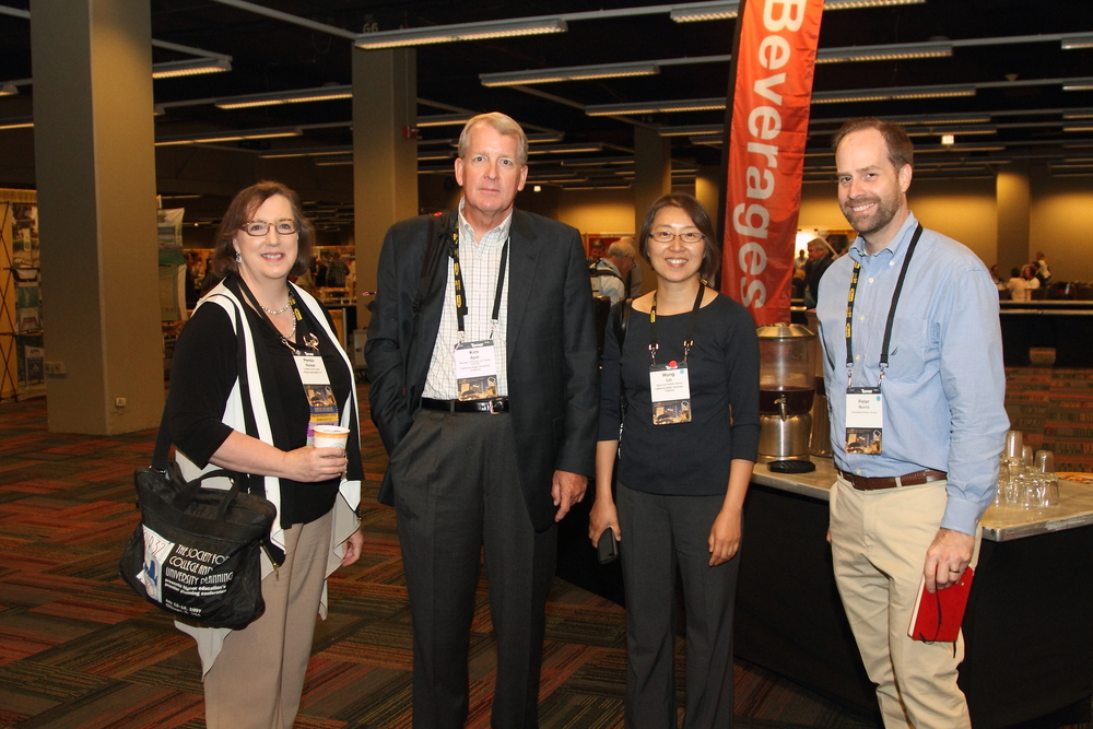 Peter Norris (most right), an architect at Integrated Design Group, poses with other conference attendees at SCUP in Chicago.