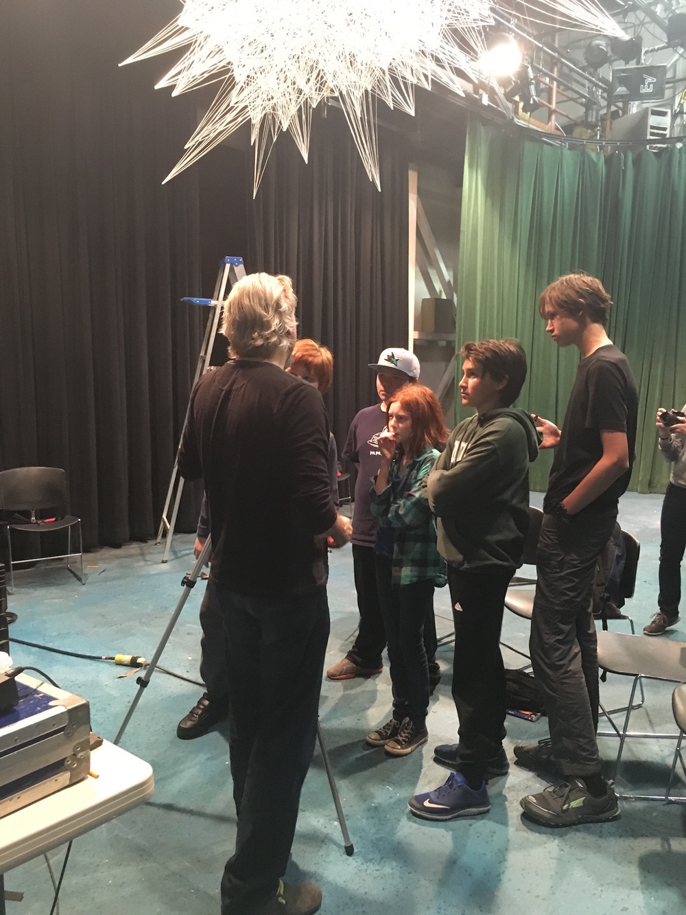 Christopher Moulder talks with the Palo Alto Children's Theatre students about mixing color for the sculpture using the theatre's lighting console.