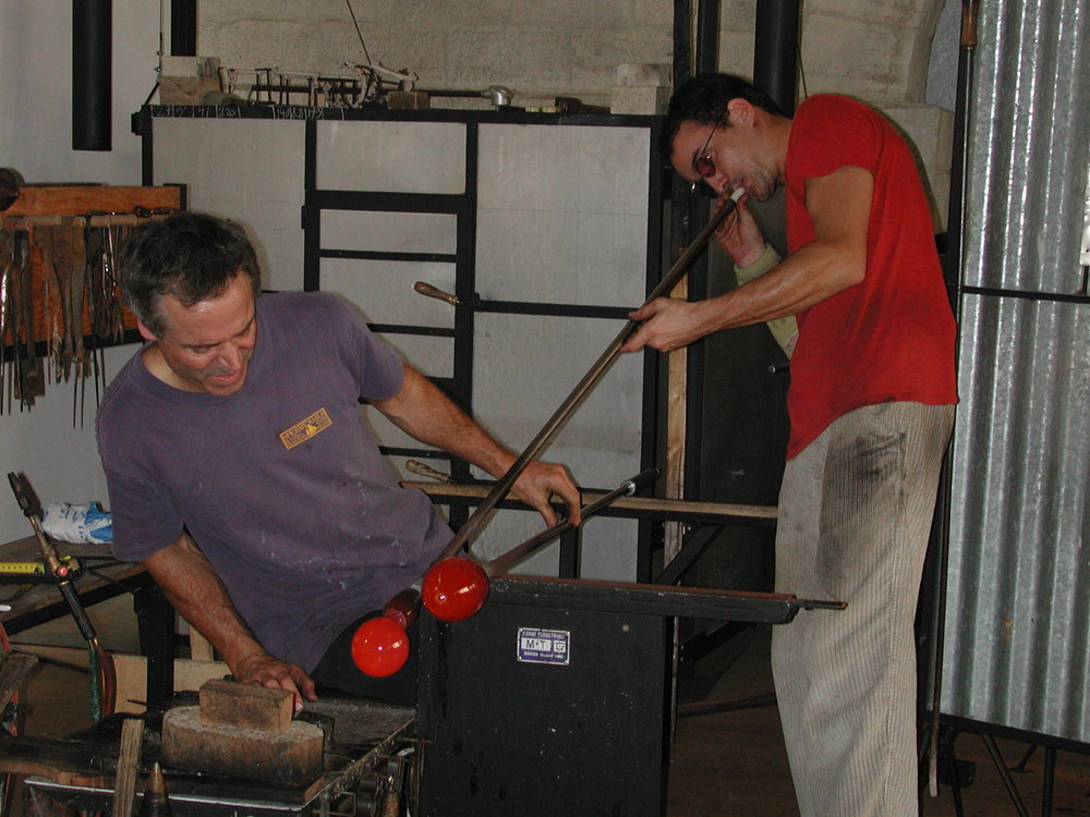 Philip Baldwin and assistant blowing the glass for the tentacle ends.