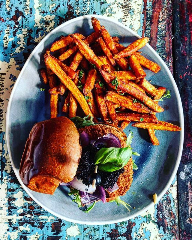 This weeks special is the fish burger topped with tomato, salad, roasted red onion and Tobiko served with our sweet potato fries!