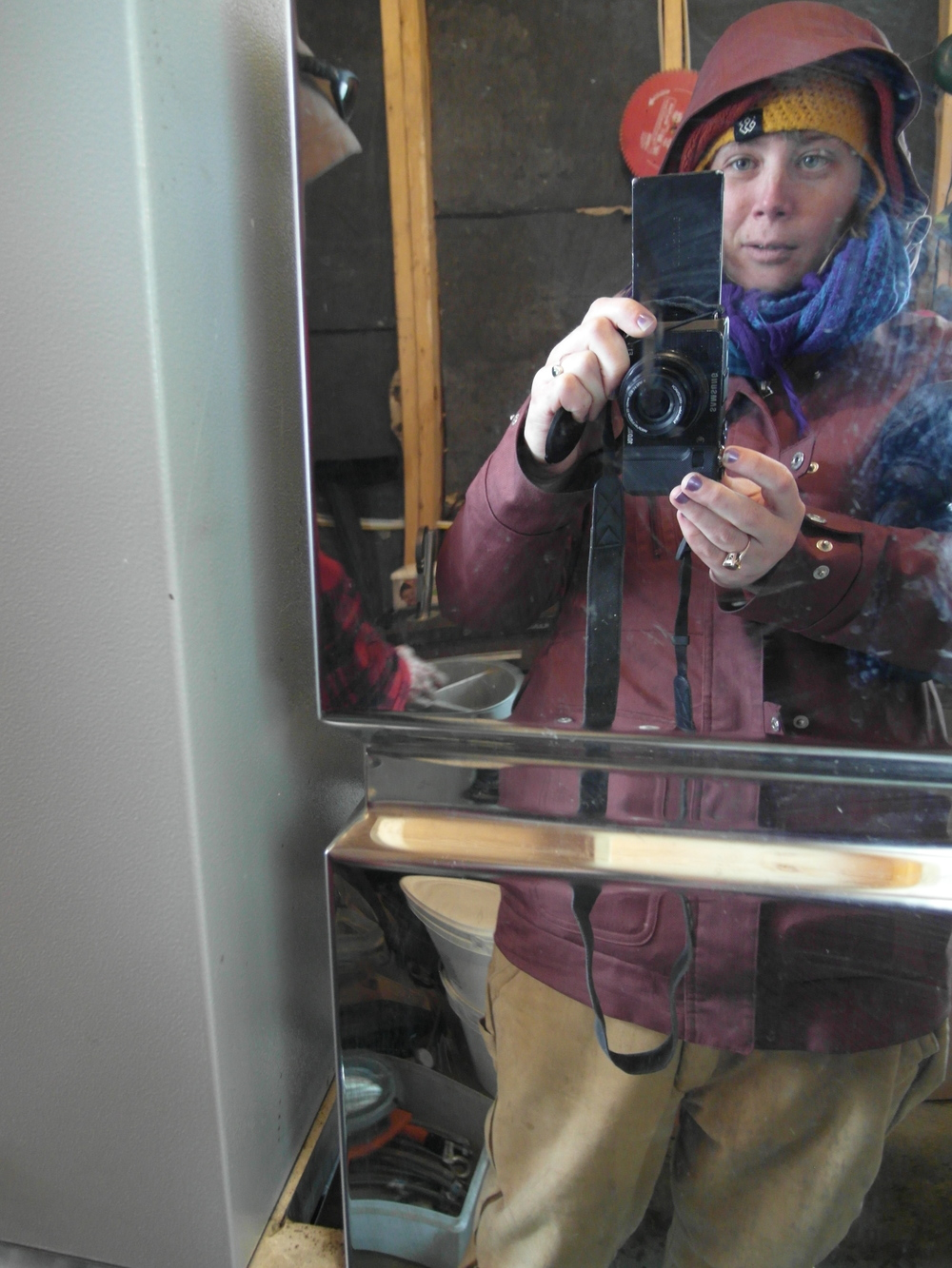 An icy selfie taken in the stainless steel reflection of the Reverse Osmosis machine.