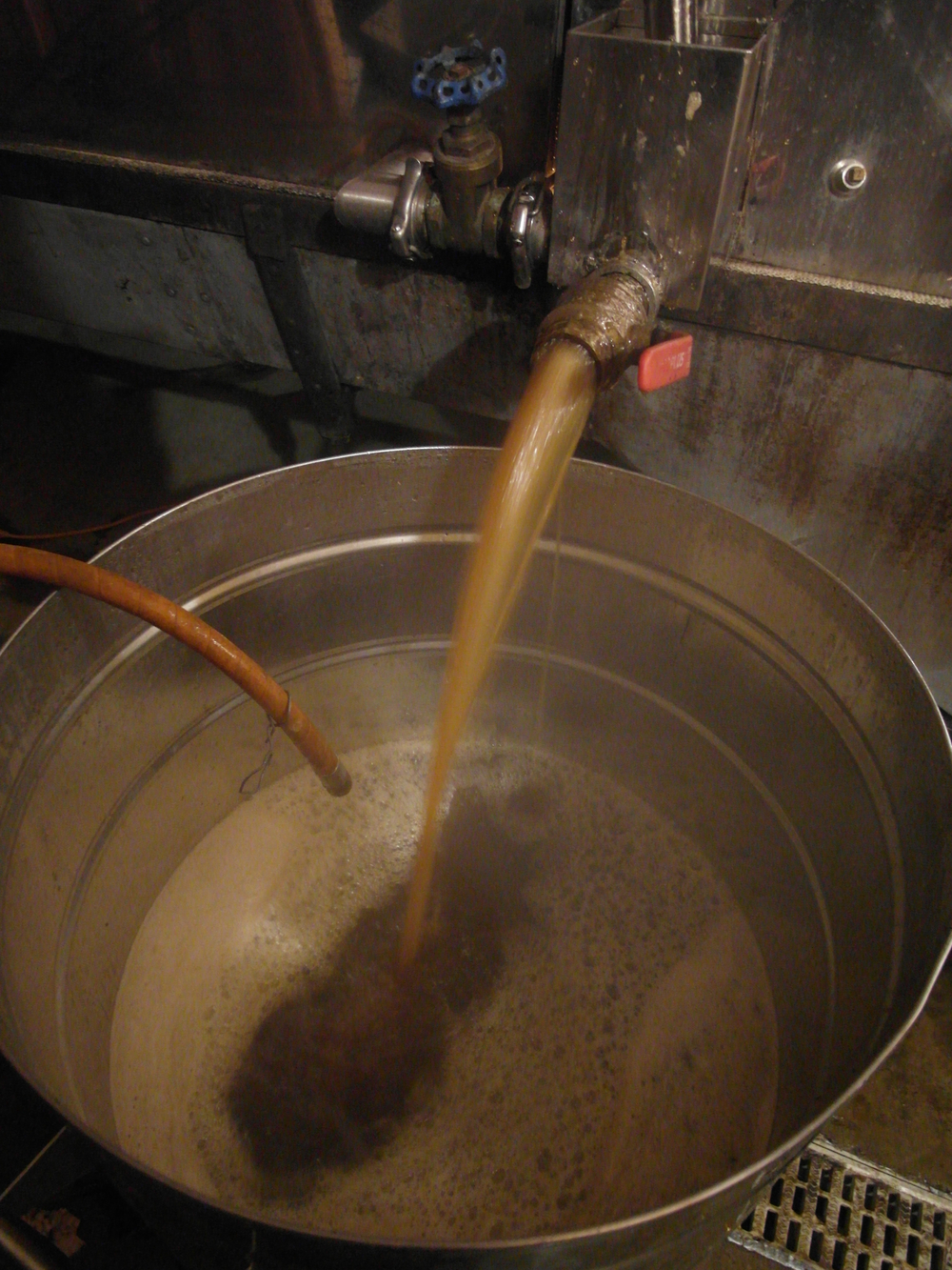 Drawing syrup off the evaporator before filtering it.