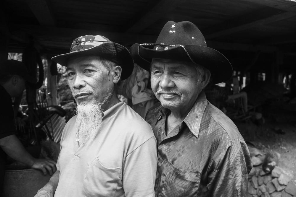 A portrait of two elderly men sporting cowboy hats. Kabayan, Benguet.