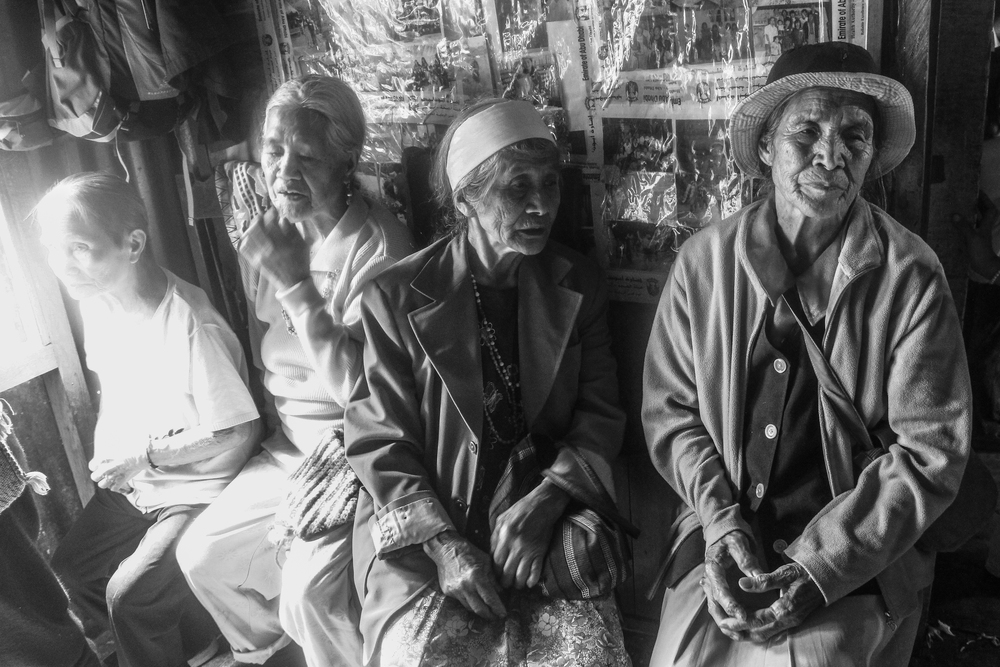 A group of elderly of women in a wedding ceremony. The elderlies play an important role in the Ikalahan community. Their involvement in decision-making and advices in community affairs are sought for. Kabayan, Benguet.