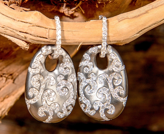 april 18 sig. diamond earrings.jpg