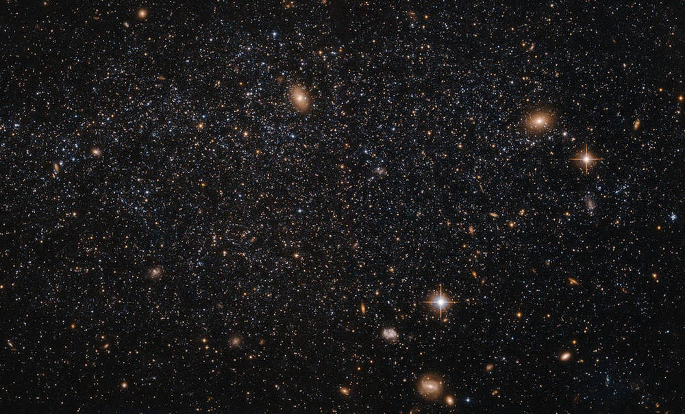 "This spattering of stars, believe it or not, is the irregular galaxy Leo A. The really bright objects are actually other galaxies in the background or stars in OUR galaxy that are ""in the way."" Photo: NASA/ESA/Judy Schmidt"