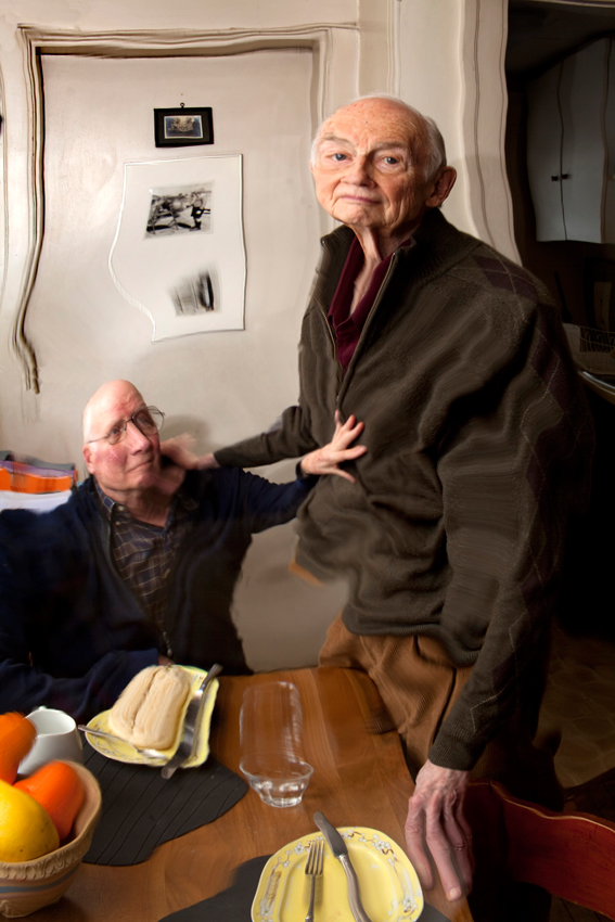 "John O'Reilly and Jim Tellin in their kitchen    2015, 43"" x 29"", Pigment print"