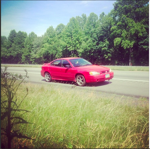 Her name was Tina. Here she is, in all of her hoopty glory - broken down on the side of the road in the middle of absolutely nowhere, North Carolina.