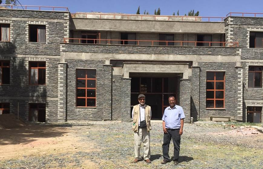 In 1993, Ethiopian Community Development Council (ECDC) established the Axumite Heritage Foundation to preserve and promote the cultural heritage of Axum and northern Ethiopia. Since 2001, ECDC been operating a library in the restored 'Inda Nebri'id, the former home of the governor of Axum. After discussions with city officials and residents, we realized that the current building could no longer meet the community's growing needs, and we began work on a permanent modern library. The new library will have enlarged reading rooms, an auditorium, and classrooms, which will be used for computer training, literacy classes, and support for local entrepreneurship.  Dr. Tsehaye Teferra, ECDC Founder and President, recently traveled to Axum to oversee the ongoing construction and reported that great progress has been made on the new building. He reported at that time that the basic structure has been completed, the roof has been installed, and much of internal framing and plastering on all three levels has been finished. Once completed, we will begin work on landscaping, installing a septic tank, a water conservation system, and solar panels. As you can see from the photos below, we are very close to our goal!  With all the progress that has been made, Dr. Teferra is requesting bookshelves to prepare for opening of the new library, and needs help finding resources for donated or reasonably priced shelves or furniture from public libraries, schools, universities, or local residents. Please contact Carrie Thiele at  Carriet@acc-den.org  to donate items or connect Dr. Teferra with resources to find the needed items.