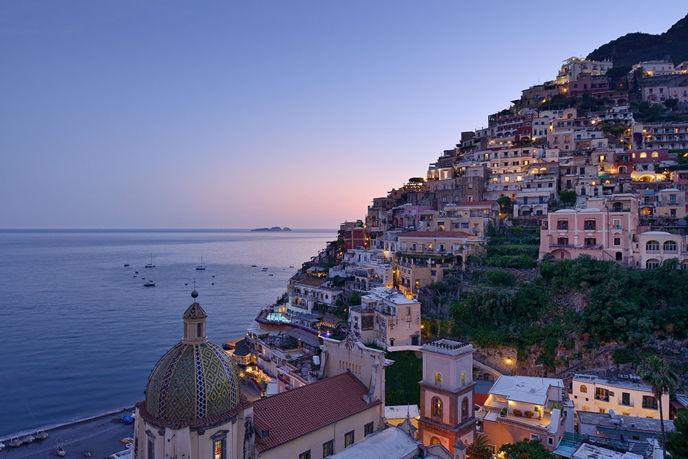 """Le Sirenuse, Italy   Dreamy, chic and oh-so-Italian, Le Sirenuse is set on the cliffs of Positano on the adored Amalfi Coast. Owned by the Sersale family, you are instantly made to feel at home here. In the words of American author John Steinbeck who was a guest in 1953, """"Positano bites deep. It is a dream place that isn't quite real when you are there and becomes beckoningly real after you have gone."""""""