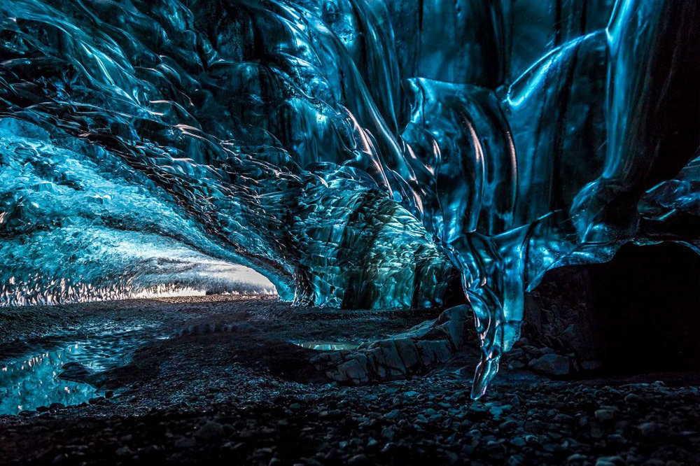 Iceland-Ice-Cave-Aurora-borealis-wilderness-holiday-northern-lights-winter-w180.jpg
