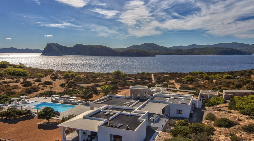 The private island: Tagomago, Ibiza    Charming chiringuitos & coastal coves, Ibiza remains one of Europe's most popular summer destinations; but set on a private paradise 900 metres off its north-east coast lies a serene retreat like no other. Accessed by boat or helicopter to arrive in style, Tagomago's five-bedroom estate is the ultimate way to experience Ibiza. Perched on a hill surrounded by spacious terraces with panoramic views in all directions, this is beyond luxury. The perfect place to party or make the most of the private island with family & friends, you are just a stone's throw from one of Europe's most sought-after spots.