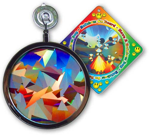"Crystal Rainbow Window Sun Catcher  Your NEW Crystal Rainbow Window Sun Catcher™ state-of-the-art Holographic Prism starts with laser technology and ends with pure spectral color. Hanging from a window in DIRECT SUNLIGHT, your Crystal Rainbow Window Sun Catcher will transform the sunlight light into an explosion of multiple hues. 4"" Diameter, laminated glass prism mounted in a silver finished chrome frame. Comes with a vinyl rubber suction cup for easy hanging. Includes a  ""Rainbow on Board"" Sun Catcher...Free!    Shop Here"