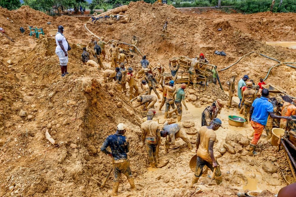An illegal gold mining operation in Kyebi, East Region, Ghana. When financial markets went into free fall in 2008, the price of gold began a four year meteoric rise to record highs as investors flowed out of riskier assets and poured into the 'safe haven' of gold, a phenomenon known as 'flight to quality'. This virtual gold rush was mirrored on the ground in Ghana as tens of thousands of Ghanaians, spurred by the lure of quick riches turned to illegal, unlicensed small scale mining known locally as galamsey, literally meaning 'gather them and sell'.