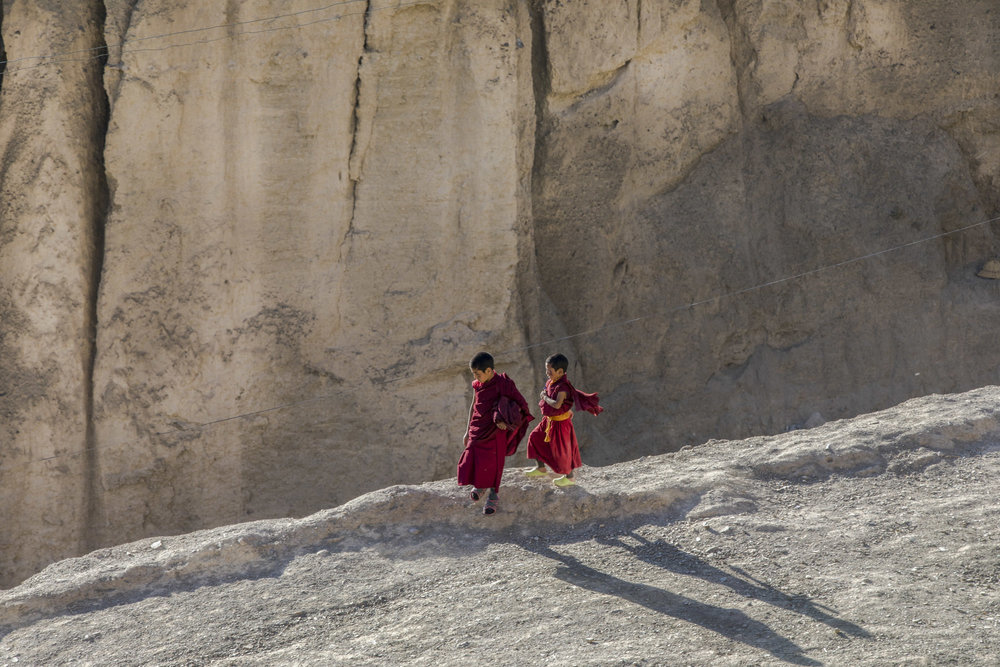 Young Tibetan monks head to prayer. Lamayuru, Ladakh. India